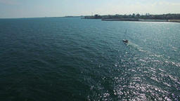 Sailboat at sea and coastline, aerial view Footage