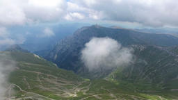 Bucegi mountains, Romania, aerial flight from the first layer of clouds Footage