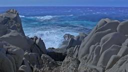 Shades of Blue Sea and Granite Rock Capo Testa Sardinia Italy Footage