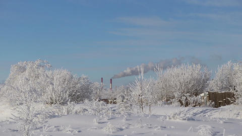 The smoke comes from the chimneys in winter Footage