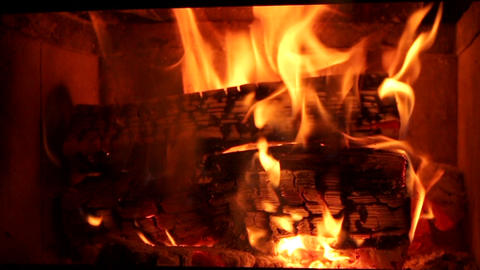 Chimney fireplace wooden fire burning with focus pull orange flames Footage
