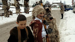 Bulgarian mummers children preparing for Surva festival Footage