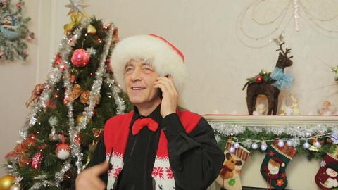 Man speaks on the smartphone. Christmas decoration Footage