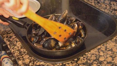 Mussels On A Big Pan Stired Footage