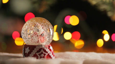 The Figurine of Santa Claus In a Glass Bowl GIF