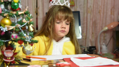The girl draws at the table Christmas drawing Footage