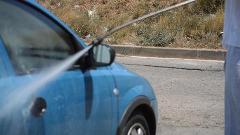 Man Washing Blue Car Live Action