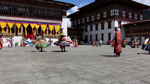 Bhutan festival with dancers in costumes and drums Footage