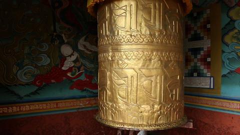 Bhutan golden giant prayer bell turning Live Action