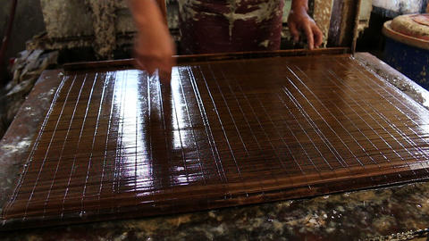 Bhutan hand working paper making layers of fibers Live Action