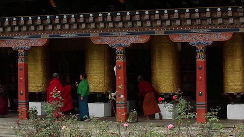 Bhutan buddhist people turning prayer bells wheels everyday life religion Footage