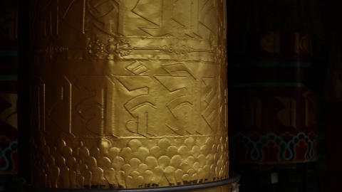 Bhutan giant golden prayer bell turning Footage