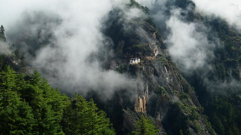 Bhutan Tigers Nest Taktshang Monastery on a mountain with clouds Live Action