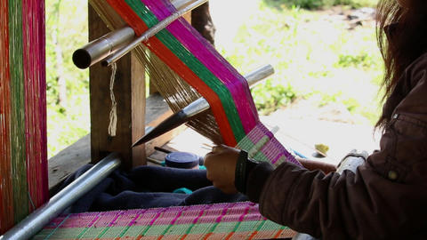 Bhutan woman weaving a colorful pattern handmade work cloth cotton Footage