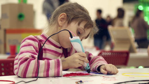 The girl paints using 3D pen Footage