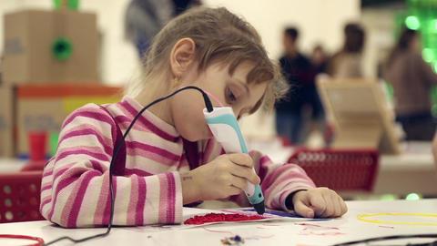 The girl paints using 3D pen Live Action