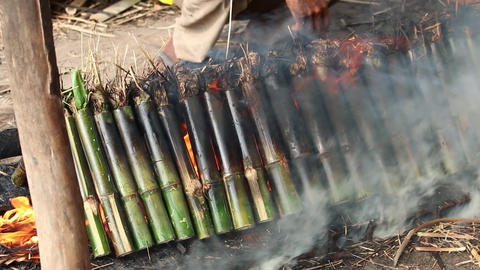 Cambodia Khmer Krolan bamboo sticky rice cooking fire Footage