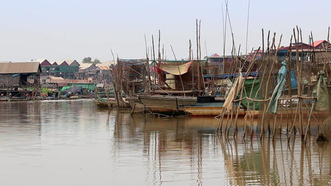 Cambodia Tonle Sap lake boats and swimming village Live Action
