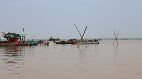 Cambodia Tonle Sap Lake fisherman on a boat Live Action