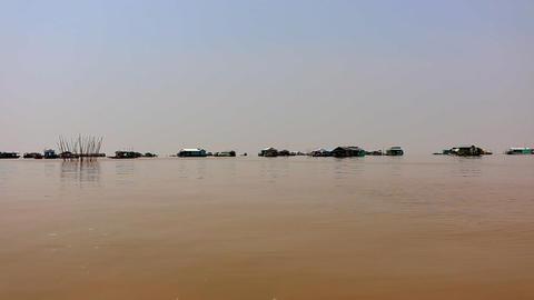 Cambodia Tonle Sap Lake panorama swimming villages Live Action