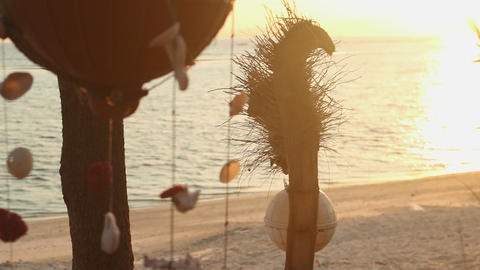Indonesia Gili Meno windbells shell mobile on the beach at sunset Footage