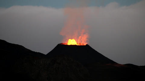La Reunion Piton de la Fournaise volcano eruption at night with lavaflow Footage