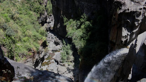 La Reunion waterfall in a canyon, mountain gorge with rainbow Footage