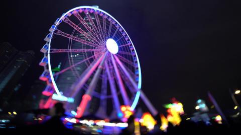 Ferris wheel illuminated at night in Hong Kong Footage
