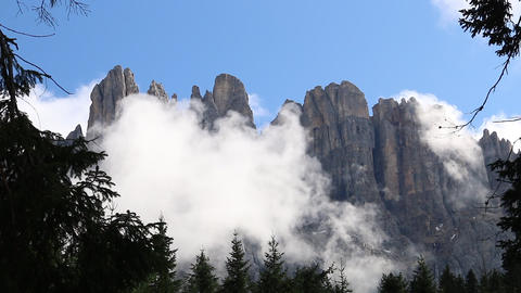 Latemar dolomites mountains with clouds and forest Italy Live Action