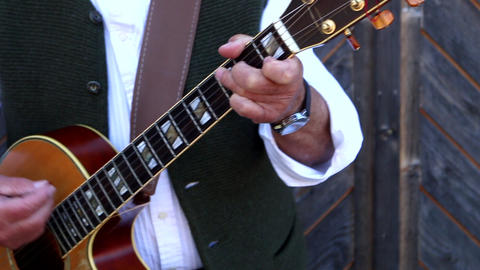Man playing the guitar instrument Live Action