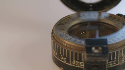 Macro shot of antique navigation instrument on dark background GIF