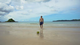 Man comes out of the sea after swimming Footage