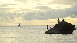 Children on a rock in the sea fishing Stock Video Footage
