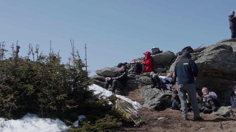 Group of tourists who stay and are at rest at the base of the cliffs on the edge Footage