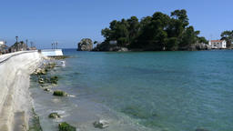 Island with dense vegetation and a small church off the port of Parga 31 Footage