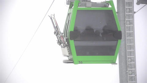 Installation of the cable car that transport skiers and ski slopes at the upper  Footage