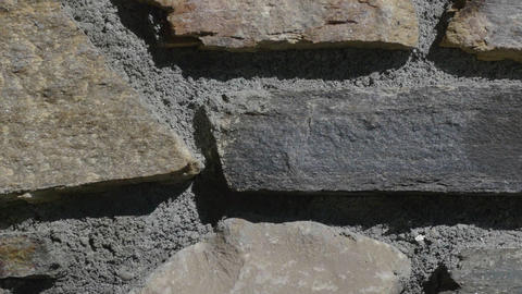 Moving upon a wall of stone blocks supportive caught up with concrete 49p2 Footage