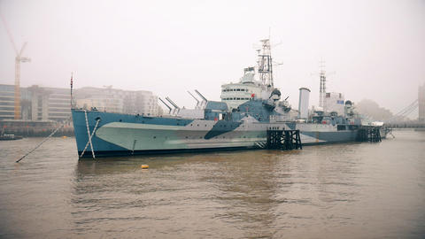 A warship on the river Thames Footage