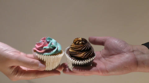 Delicious cupcakes. Colored muffins on hand Footage
