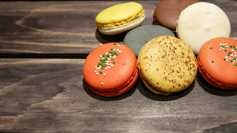 Colorful macaroons on dark wooden background 영상물