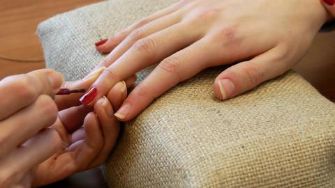 Female hands with red manicure indoors Footage