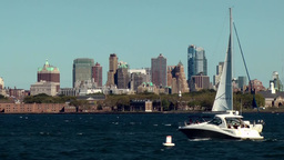 USA New York City 407 Liberty Island; Brooklyn cityscape behind boat traffic Footage