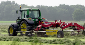 Tractor Haying And Raking In The Netherlands stock footage