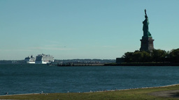 USA New York City 423 statue of liberty gives farewell to cruise ships on Hudson Footage