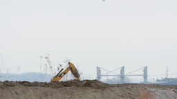 Excavator on a harbour construction site Footage