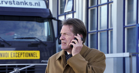 Businessman Calling In Front Of Truck stock footage