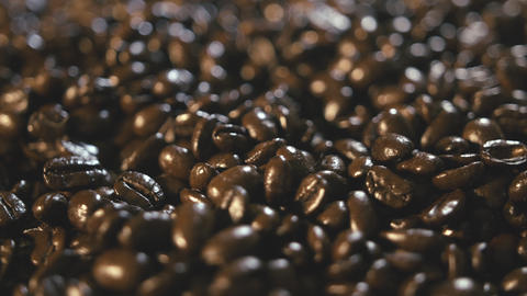 Organic Coffee Beans Pile Extreme Close Up Rotating Left stock footage