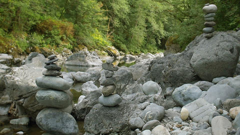 Zen Rock Piles Balanced In Nature Along Forest River stock footage