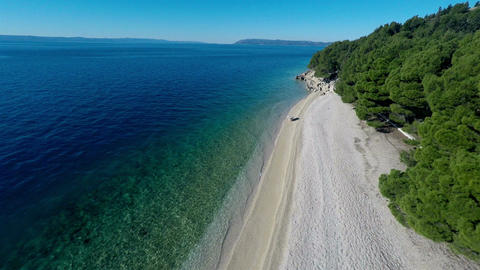 Aerial view of empty beach and calm sea