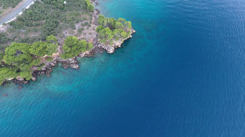 Aerial view on blue sea and rocky mediterranean coastline Footage